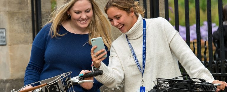 Oxford Media And Business School Two Students With Bikes