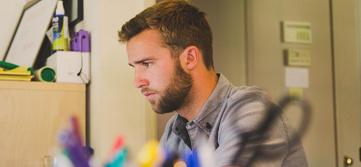 Oxford Media & Business School - boy In bedroom Studying 1230x570