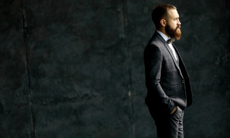 Oxford Media and Business School - bearded man in a suit